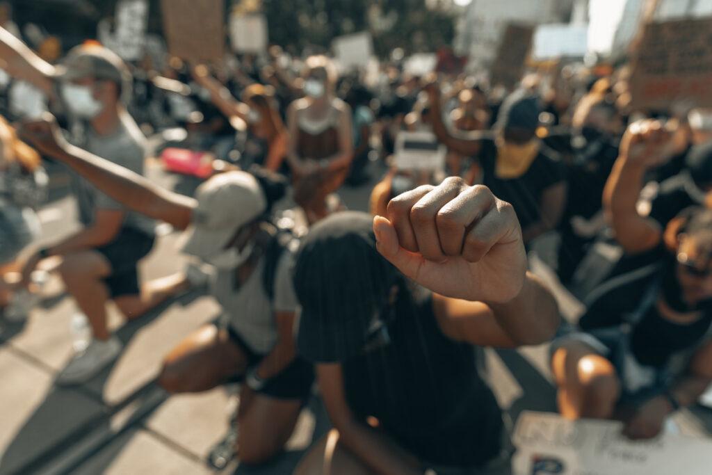 fists raised - black lives matter - crucify him - relevancelive